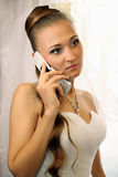 Bride speaks on the phone Stock Photos