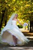 Bride spinning Stock Photo
