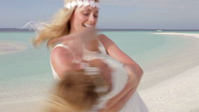 Bride Spinnning Bridesmaid Around At Beach Wedding stock video footage