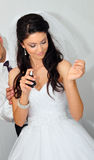 Bride spraying perfume Stock Photo