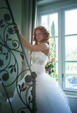 Bride on stair in house Royalty Free Stock Photography