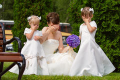 Bride with little girls. Bride stand with little girls in elegant dresses Stock Photos