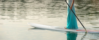 Bride stand up paddleboard02 Stock Images
