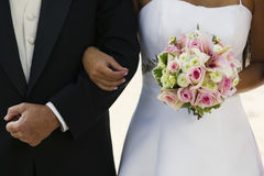 Bride Standing Arm In Arm With Father Royalty Free Stock Images