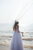 Bride is standing on the beach Royalty Free Stock Images