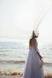 Bride is standing on the beach Stock Photo