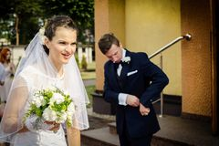 Bride standing in front of the church holding a bridal bouquet Royalty Free Stock Photography