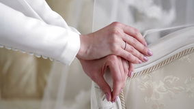 Bride standing beside his chair. In interiere Stock Photography