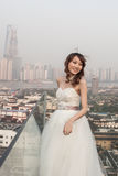 Bride standing  ouside with huangpu river Royalty Free Stock Image