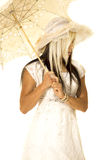 Bride standing with umbrella look down to side Royalty Free Stock Photography