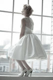 Bride standing on the window Royalty Free Stock Photos
