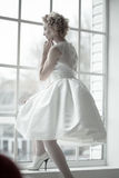 Bride standing on the window Royalty Free Stock Image