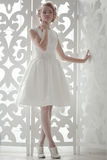 Bride standing on the window Royalty Free Stock Images