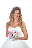 The bride stands with  flowers and in a jewelry Stock Image