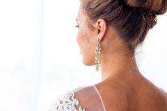 The bride stands with her back. The bride is standing with her back in the wedding dress Royalty Free Stock Photos