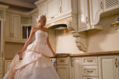 Bride stands in the kitchen Stock Photos