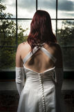 Bride staring out window. Bride is staring trough the window Stock Photos