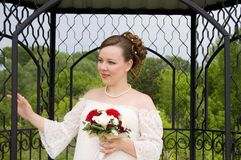 Bride in steel cage with beautiful bouquet Stock Images