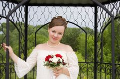 Bride in steel cage with beautiful bouquet. Bride in steel cage. Her wedding day Stock Photography