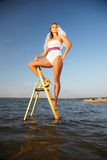 Bride on stepladder stock image