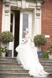 Bride on steps Royalty Free Stock Photo