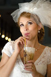 Bride with straw. Beautiful bride portrait drinking with straw Stock Photos