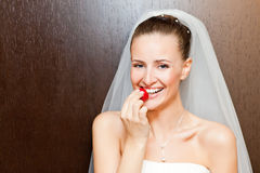Bride with strawberry Stock Images