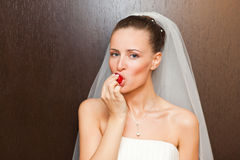 Bride with strawberry Royalty Free Stock Photo