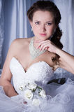Bride with stylish make-up in white dres Royalty Free Stock Image