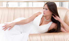 Bride with stylish make-up in white dress Stock Photo