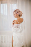 Bride with stylish make-up in white dress Stock Photos