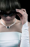 Bride in sunglasses. Image of a bride in sunglasses on black Stock Image