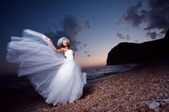 Bride on sunset beach Royalty Free Stock Photo