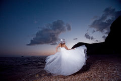 Bride on sunset beach Stock Photos