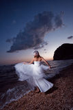 Bride on sunset beach Stock Image