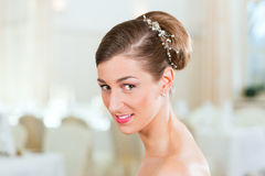 Bride with swept-back hair. Smiling bride with swept-back hair before the wedding Stock Image