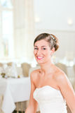 Bride with swept-back hair. Smiling bride with swept-back hair before the wedding Stock Images