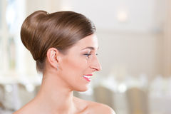 Bride with swept-back hair. Smiling bride with swept-back hair before the wedding Royalty Free Stock Images