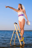 Bride in swimsuit in the sea on stairs Stock Photography