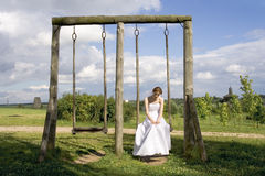 Bride on a swing. Young woman (bride) on a swing Stock Photography