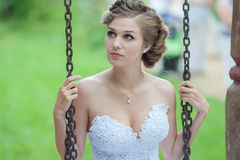 Bride on a swing. Beautiful bride on a swing Stock Images