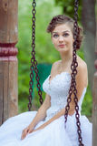 Bride on a swing. Beautiful bride on a swing Royalty Free Stock Image