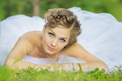 Bride on a swing. Beautiful bride on a swing Royalty Free Stock Photography