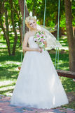 Bride on a swing Royalty Free Stock Images