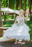 Bride on a swing Stock Photo
