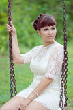 Bride on a swing. Bride swinging on a swing Stock Photo