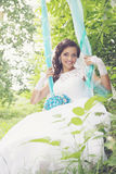Bride on a swing, tinted Stock Photography