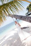 Bride  swinging on tropical sea side background Stock Images
