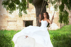 Bride on the swings Royalty Free Stock Image