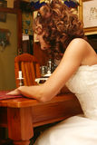 Bride at the table Royalty Free Stock Photos